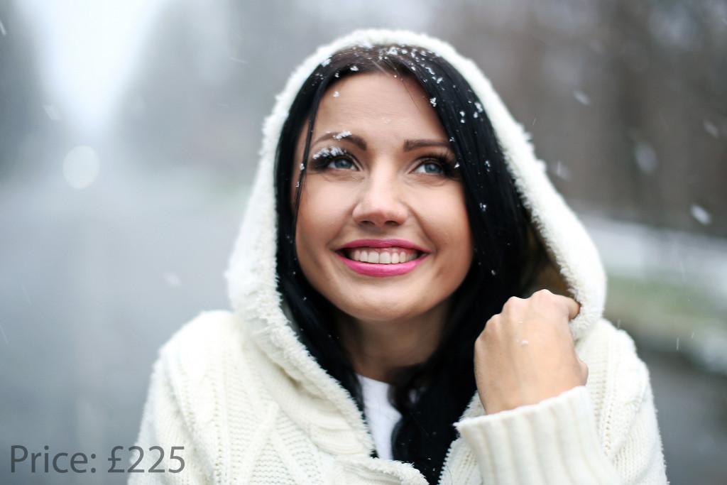girl in winter on the street under the snow